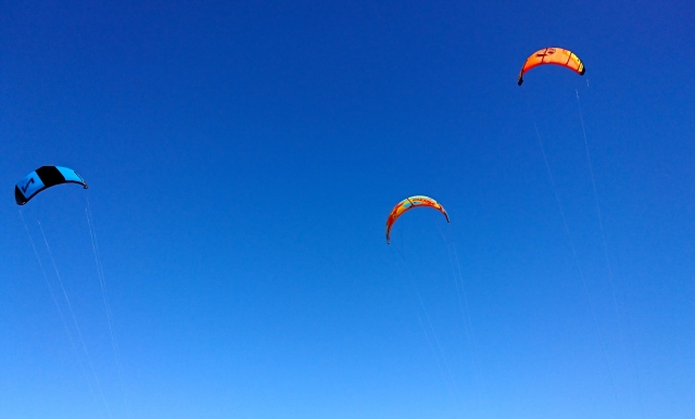Cabarete Kite Surfers on a blue sky